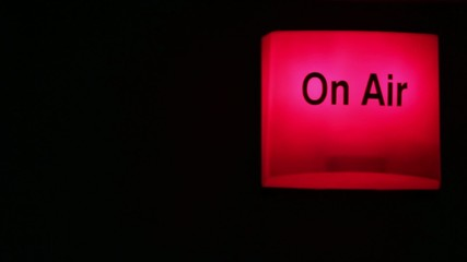 On-air sign being turned on and off