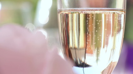 Champagne with bubbles in wedding decorated glasses, closeup