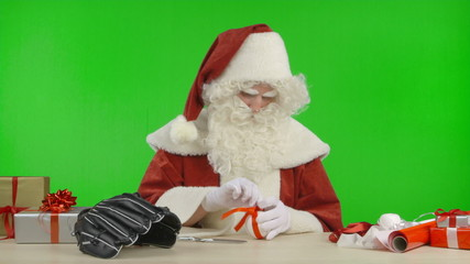 Santa Claus is Tying a Bow on a Baseball