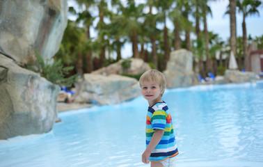 Little baby boy near swimming pool