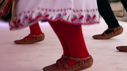 Bulgarian traditional dancers play in beautiful costumes