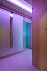 Violet neon lighting in luxurious apartment