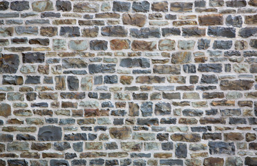 Old brick or stone wall background