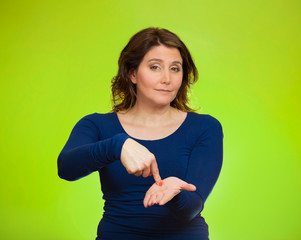 Woman gesturing pay me my money back, green background