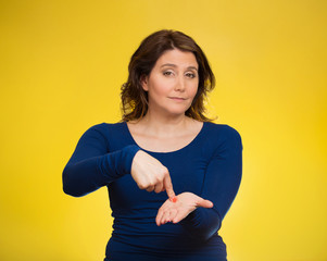 Woman gesturing pay me my money back yellow background