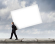 Businessman carrying cube