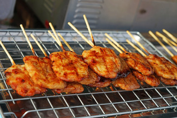 grilled pork with stick on stainless mesh