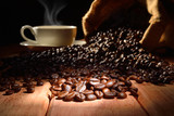 Coffee cup and coffee beans on old wooden table © amenic181