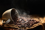Fototapeta Kawa jest smaczna - Coffee beans with smoke in coffee cup © amenic181