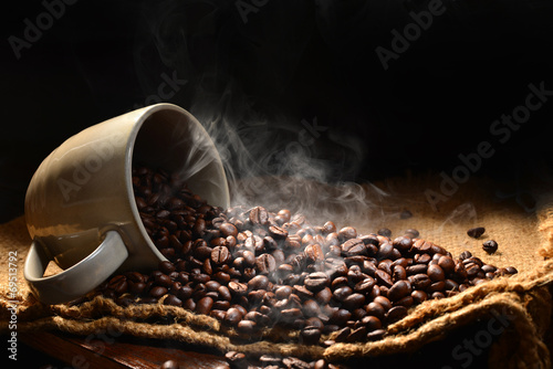 Coffee beans with smoke in coffee cup