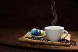 Fototapety Cup of coffee with coffee beans and pastries on wooden table
