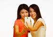 Asian young girls making a selfie with mobile phone with focus o
