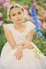 Summer garden - beautiful girl  in the flower garden