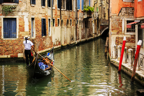 Fotobehang Venetie Venice, Italy - Gondolier and historic tenements