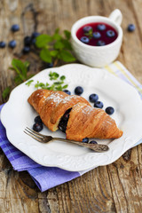 Breakfast, croissant with blueberries