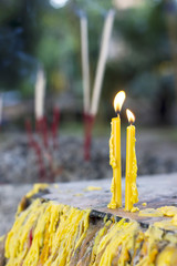 prayer candles in Buddhism