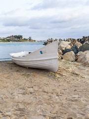 Abandoned fishing boat on the beach