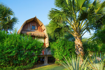 Wooden bungalow on a tropical beach resort on Bali