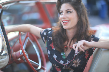 Lovely Woman Posing and and Around a Vintage Car