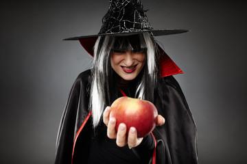 Sorcerer offering a poisoned apple