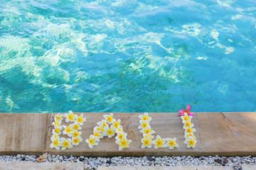 Word Bali written with frangipani flowers