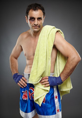 Bruised fighter with towel