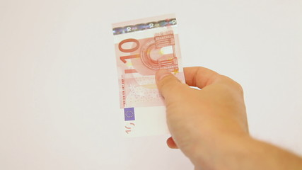 Closeup of hand paying ten euro