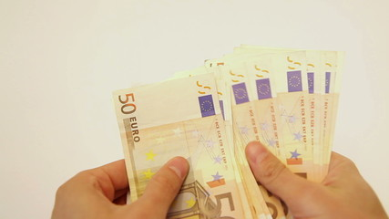 Counting euro cash and placing it into envelope