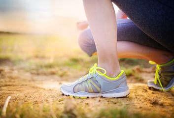 Woman running feet closeup