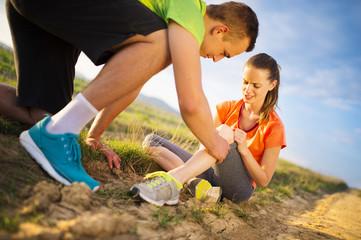 Female runner with injured knee