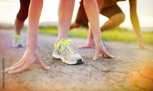 canvas print picture Couple running feet closeup