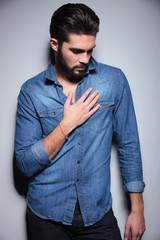Man with his hand on the chest