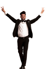 elegant man wearing tuxedo celebrating success