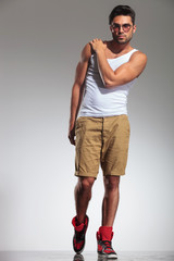 fit man with hand on shoulder posing