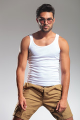 portrait of a fit man in undershirt and glasses