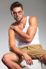 fit casual man with hand on shoulder sitting