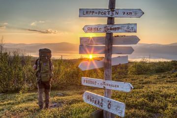 Hiker at Midnight Sun in Sweden
