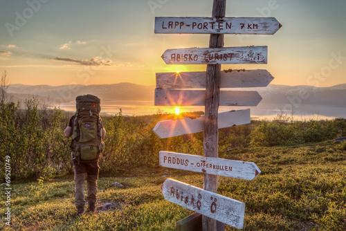Hiker at Midnight Sun in Sweden - 69520749