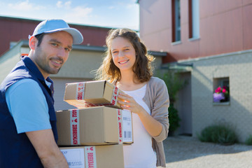 Young attractive woman checking her parcel