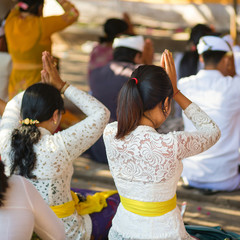 Balinese young women praying in temple