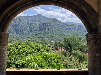 The Magic Town of Tepoztlan, Mexico framed from a monastry arch