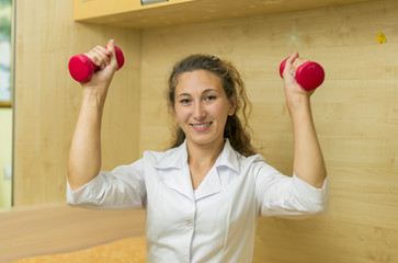 Doctor with dumbbells