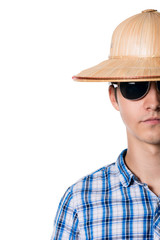 Half face shot of a guy with a straw hat with sunglasses.