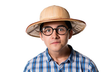 Portrait of a funny young man in a straw hat and sunglasses with