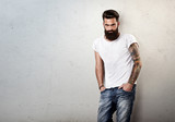 portrait of tattooed bearded man wearing blank t-shirt