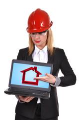 engineer holding laptop