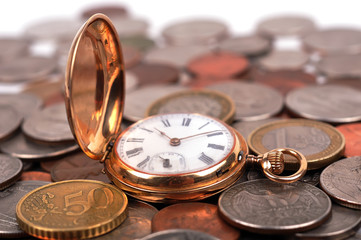 pocket watch and coin