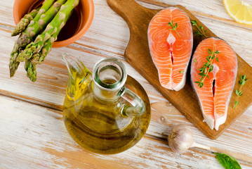Healthy food  ingredients - salmon, vegetables and olive oil