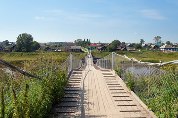 Old suspension bridge over the River Tura