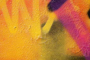 Detail of colorful illegal graffiti on public wall.